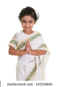 Cute Toddler Dressed in Saree with Folded Hands Representing Traditional Indian Greeting, Namaste, Isolated on White