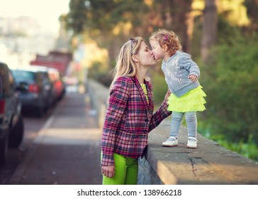 Cute Toddler Girl Kissing Her Mother