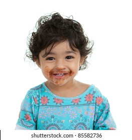 Cute Toddler Girl with Mouth Smeared with Chocolate, Isolated, White