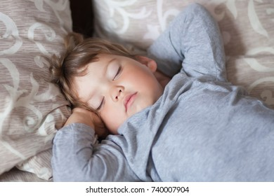 cute toddler girl sleep in the bed in her badroom, indoors