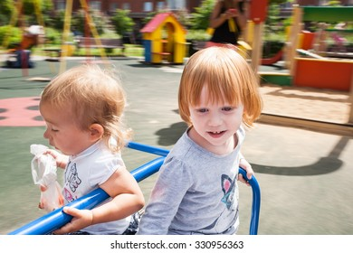 Cute  toddler girls on a carousel