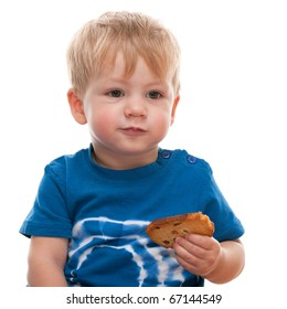 A cute toddler is holding a slice of bread in his hand; isolated on the white background
