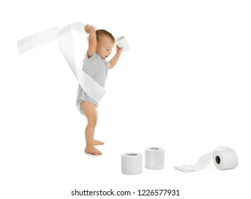 Cute toddler playing with toilet paper on white background