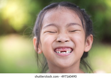 cute toothless girl close up face