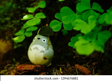 Cute Totoro, a famous Ghibli studio character from Japan, placed under clovers in Hot Rainforest, Washington state USA. April 30, 2019