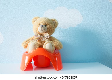 Cute toy sitting on the potty