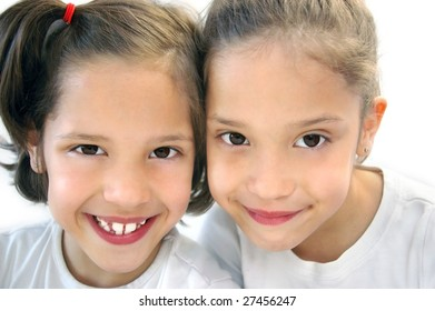 Cute Twin Girls isolated on white
