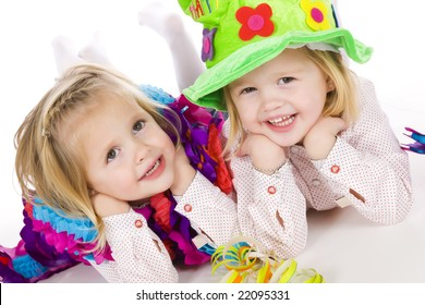 cute twin sisters celebrating their 4th birthday
