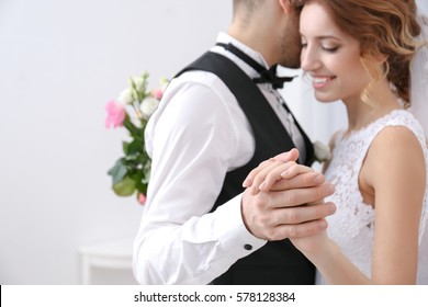 Cute wedding couple dancing at home