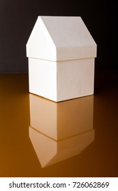Cute white house, shaped box on golden background