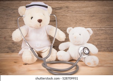 Cute White Teddy bear wear nurse use stehoscope check health bear baby