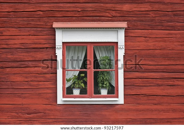 Cute window on red swedish house wall