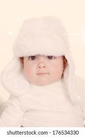 cute winter baby in furry hat