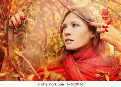 Cute Woman in Autumn Park. Fashion Model Outdoors