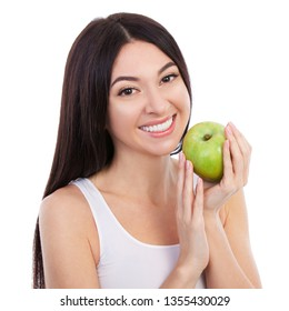 Cute woman with beautiful snow-white smile holding green apple. Healthy lifestyle and nutrition, dieting, weight loss, cosmetology, dental care and healthy teeth consept. Close up portrait