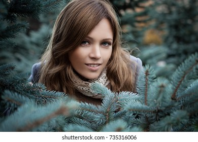 Cute Woman in Fir Forest Outdoors
