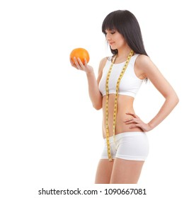 Cute woman with grapefruit and measure tape isolated on white background. Close up of sporty and beautiful female body. Healthy lifestyle, dieting, fitness, weight loss concept