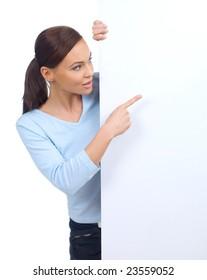 Cute woman holding an empty white board