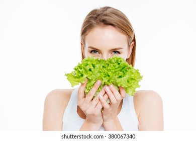 Cute woman holding green salad isolated on a white background