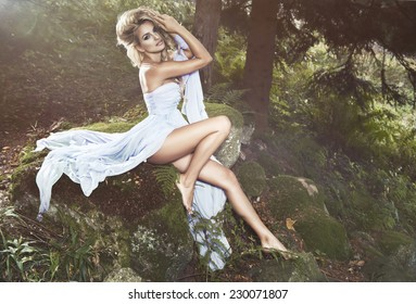 Cute woman in nature scenery