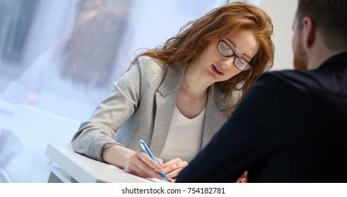 Cute woman questioning job applicant during interview