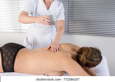 cute woman Receiving a candle massage