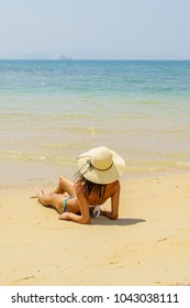 Cute woman relaxing on the summer beach