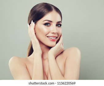 Cute Woman Smiling. Spa Model Face with Healthy Skin and Straight Hair. Facial Treatment, Cosmetology, Beauty, Skin Care and Spa