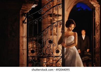 cute woman stands near the gate