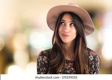 Cute woman thinking