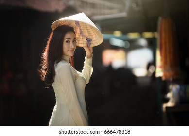 Cute woman with Vietnam culture traditional dress,traditional costume, Ao dai is famous traditional Vietnam costume.