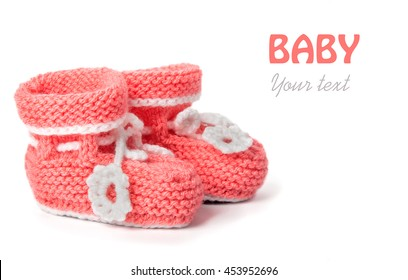 Cute woolen baby shoes on white background