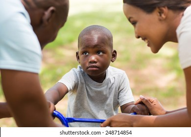 cute young african family playing outdoors