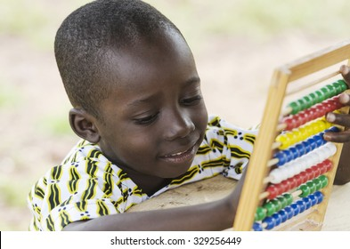 Cute Young African Schoolboy Learning to Count with an Abacus in his school in Bamako, Mali.