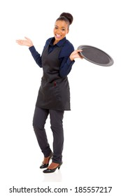 cute young african waitress holding empty tray