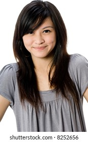 A cute young Asian woman in grey dress on white background