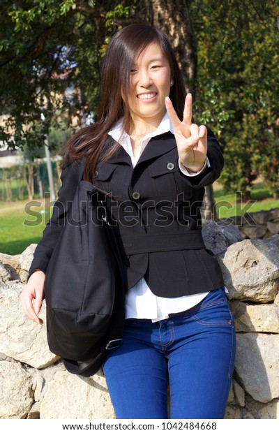 Cute young asian woman taking sun in spring