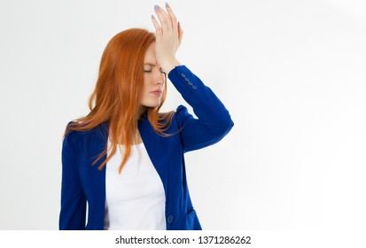 Cute, young beautiful red hair woman do facepalm. Redhead girl headache failed to upset business face palm. Portrait of female doing facepalm posing against studio background.