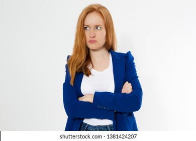 Cute, young beautiful red hair woman do facepalm. Redhead suffer girl headache failed to upset business face palm. Portrait of female doing facepalm posing against studio background.