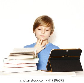 cute young boy with books and electronic tablet