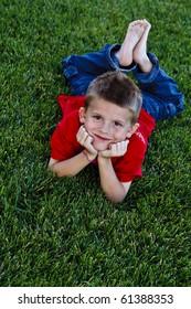 Cute, young boy enjoying the outdoors