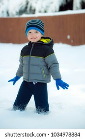 Cute young boy playing in snow