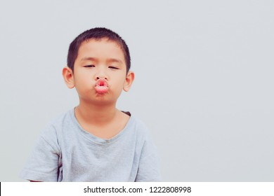Cute young boy puckering up for a kiss. Funny face.