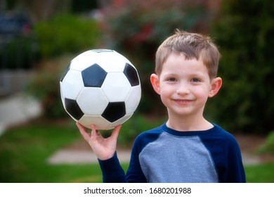 Cute young boy with soccer ball