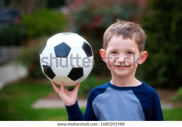 cute-young-boy-soccer-ball-600w-16802019