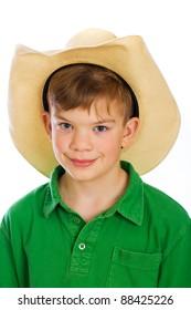 A cute young boy wearing a cowboy hat.