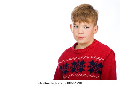A cute young boy wearing a red Christmas sweater.