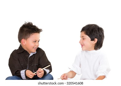 Cute young boys playing together isolated over white background.