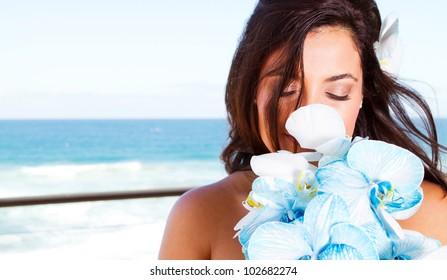 cute young bride smelling bouquet