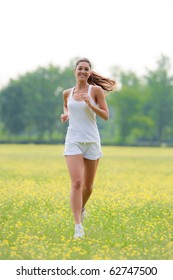 cute young caucasian woman running outdoors.Concept of healthy lifestyle